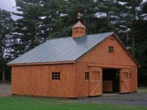 Barn shed garage builders horsebarns log cabins log homes for Log pole barn