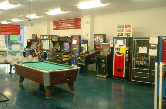 Laundromat with Pool Table, Arcade, Free WiFi, Cable TV and Giant Washers and Giant Dryers.