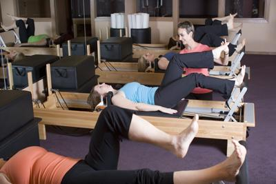 Group class using the Reformer at Pilates Northwest.
